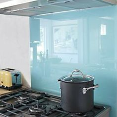 DIY kitchen backsplash- colored glass on plywood for a non-permanent backsplash perfect for rental units by herland