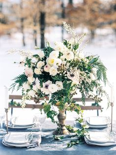 wild textured tall centerpiece, elevated centerpiece design, greenery centerpiece, winter reception decor from snow winter virginia wedding inspiration