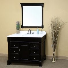 3.Constructed from pure birch wood, this single bathroom vanity is perfect for a small yet stylish bathroom. With an Espresso finish, this elegantly designed bathroom vanity comes with a white marble countertop and a white ceramic sink. Its antique brass finish hardware provides unmatched strength and durability. Add this vanity in  your bathroom at just $1,484.00.