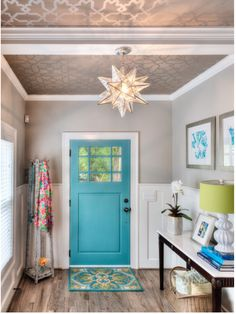 Revere Pewter Benjamin Moore on walls. Mediterranean Sherwin Williams on door.