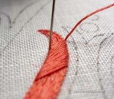 Satin stitch: Slanting Stitches - why I start in the middle of the design element - www.needlenthread.com
