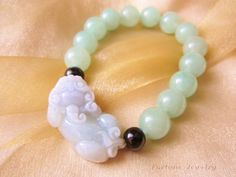 $55.00 Gorgeous Chinese Tiger Quality Carved Light Green Jade (3.5 cm x 2 cm x 1 cm) Bracelet with 1.2mm Jade Beads - Feng Shui Jade Jewelry by Fortune Jewelry & Healing Beauty, http://www.amazon.com/dp/B00CLFAFNE/ref=cm_sw_r_pi_dp_EyIPrb19VFXHC