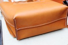 Hand stitched with good quality vegetable tanned cow leather - Stylish and special - suitable volume for daily use - it can include a pouch, wallet, coincase and cellphone. - Strap can be removed and became a tote bag - Approx. dimension : 32cm (L) (measured at the rim of the bag) X 25cm (H) X 10cm (D) (at the base). - Dark brown, Black, Beige color leather are also available now! For the leather color example, please go to below listing…