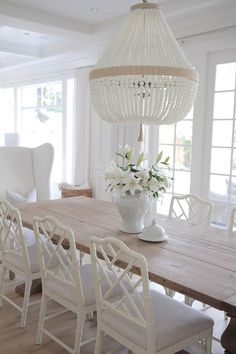 Jackson MS Top Picks Showrolake home Neutral Dining Room. Neutral Dining room with reclaimed wood table, white chairs and white beaded chandeliers. Table And Chairs, Side Chairs, Wood Tables, Trestle Table, Bag Chairs, Lounge Chairs, Table Lamps, Home Interior, Interior Design