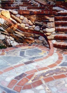 Stone and brick masonry stairs instead of our ugly concrete blocks and cement?