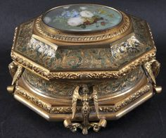 A FINE FRENCH GILT ORMOLU OCTAGONAL ETCHED CASKET, the lid painted with an oval floral plaque. 6.5ins wide.