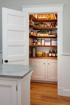 Custom pantry with shelves above, doors below. Handcrafted from Maple, finished in Wimborne White by Farrow & Ball. Crown Point Gallery 94.10