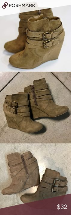 Nine West Taupe Suede Buckled Booties Boots Sz 6 Nine West Taupe Suede Buckled Booties Boots Sz 6  Very comfortable bootie wedges in taupe/light brown color. Double buckles around the top.  ✧ Women's Size 6 - fits true to size  ✧ Great condition, only worn a couple of times, no signs of significant wear; please see pics   Great deals on bundles!! Adding lots of new pieces to the FactoryMint closet!!  ✦ Follow me on Instagram ⇢ @factorymint Nine West Shoes Ankle Boots & Booties