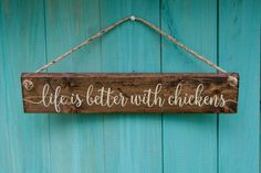 This rustic wood sign that says Life is Better with Chickens is the perfect decor for your chicken coop. It would look great hanging on your coop door or on a shepherds hook.  The sign is distressed and stained a dark walnut color to give it that rustic farmhouse style. The flowy calligraphy letters are painted with ivory chalk paint. Each sign is finished with an outdoor rated satin clear coat to protect it for years to come.  ❤ SIZE: The size is approximately 18 inches long x 3.5 inches…