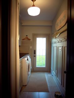 Completed laundry room// moulding + cabinets Martha Stewart Bedford Gray.  Walls MS Heavy Goose