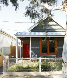 Front of house. Sweet handpainted white pattern detail by Emily – looks so cute on those dark grey weatherboards! Also, Emily says she lov...