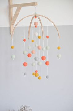Mobile wood and felt balls / handmade by drouandlittlepoux on Etsy / nursery / nursery mobile / handmade nursery mobile / colorful felted wool / #commissionlink