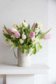 stoneware jar, stoneware vase, tulip bouquet, daffodil bouquet, Victorian mantlepiece, limestone mantlepiece, soulfoodstudio shop, interior stylist, interior designer, pink flowers