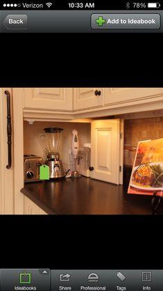 Appliances in a little hideaway cupboard on the surface