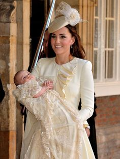 Kate Middleton's cream-colored dress and hat matched her son's attire at his christening today 10-23-13.