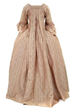 Rear view, robe à la Francaise (sack-back gown), 1770–1774. Light pink silk, woven with small cream flowers, fabric trimming.