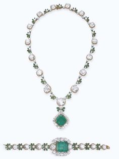 AN EMERALD AND DIAMOND SUITE, BY MOUAWAD