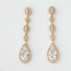 Dazzle your ears with these elongated pear or teardrop CZ dangle earrings. These earrings are a fabulous choice for weddings, proms, homecomings or any special occasion in need of some extra sparkle! Pierced post backs and 2 1/8 inches long. Rhodium plated, gold plated or rose gold plated, grade AAA cubic zirconia and lead free.