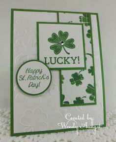 handmade St. Patrick's Day card from WeeBeeStampin4Fun ... white and green ... shamrocks galore ... pretty plaid shamrocks on white patterned paper ... embossing folder shamrock outlines on main panel ... like it!!