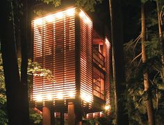 Posing as a Japanese lantern on stilts, the 4Treehouse by Lukasz Kos floats within the fir trees on Lake Muskoka, Ontario. Letting the existing trees set the parameters of the project, the tree house was constructed around the base of four existing trees, rather than stretching between them. The project was an exercise in minimising impact to the trees, site, and nature itself.