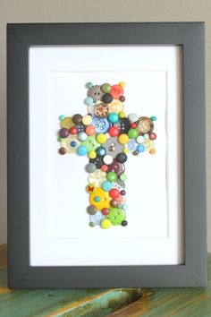 Button Cross Art by OnAgain on Etsy, $25.00...could definitely do for less with all of the buttons i have!