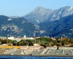 Forte dei Marmi It's rare for me to swim in the sea and want to look back at the shore . However in Forte dei Marmi i cant resist . The hills take my breath away My Travel Map, Places To Travel, Places To Visit, Home And Away, Amalfi, Alps, Hotels And Resorts, Wonderful Places, Tuscany