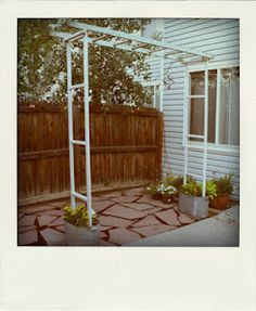 Garden arbor made out of a vintage ladder.