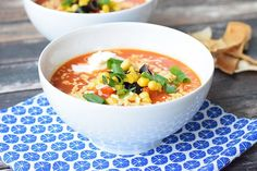 A hearty tortilla soup with homemade tortilla chips, sour cream, grated cheese and corn. Low FODMAP, gluten-free, lactose-free and vegetarian.