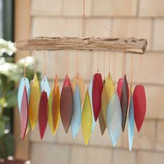 Colorful feather-shaped wind chimes.