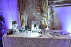Elegant gift table display.  For rent - manzanita tree, crystal ornament balls, crystal strands, white rosette linen and risers and misc. rhinestone frames. www.milwaukeeweddingcenter.com www.facebook.com/milwaukeeweddingcenter