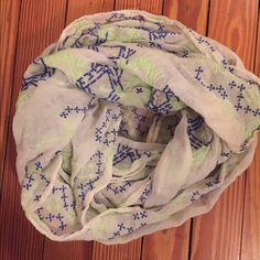 Infinity Scarf White with blue and green embroidery. Only worn a few times. Looks perfect with a cobalt top! American Eagle Outfitters Accessories Scarves & Wraps