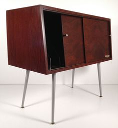 "Mid-Century Modern RCA Victor Record Cabinet. 30 1/8"" tall, 35"" wide and 16 3/4"" deep. Cabinet alone is 15 5/8"" tall. Legs are 14 1/2"" long."
