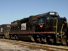 Three Notch Railroad GP38 #2728 sits in the clear as a contractor with a tie gang inserts new cross ties into the main track Description: TNHR GP38 #2728 was built September 1969 as Southern Railway #2728 and later became Norfolk Southern #2728 Photo Date: 4/26/2003 Location: Dothan, AL Author: Bernie Feltman Categories: Roster Locomotives: TNHR 2728(GP38)