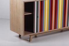 "Wewood buffet ""Madison"" in oak wood, two sliding doors, one painted with lacquered colorful stripes, the other in lacquered white. 50's style. Wewood, Portugal, contemporary. #Wewood #buffet #furniture #Madison #oak #wood #colors #stripes #rainbow #1950s #Portugal #contemporary #design #BellamysWorld"