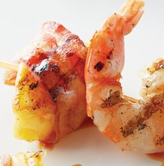 Bacon-Wrapped Shrimp with Pineapple Tidbits are the perfect marriage of salty and sweet. The maple-sriracha glaze will have you coming back for more!