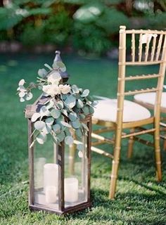 lantern and green floral decorated wedding aisle ideas