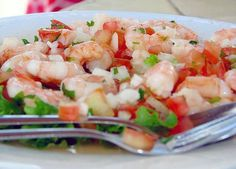 Mexican Appetizers: Shrimp Ceviche (Ceviche de Camarones)  - A refreshing, spicy dish that can be made with many different types of seafood, but shrimp ceviche is one of the most popular: raw shrimp cooked by lime juice and marinated with onion, tomato, chile, and then topped off with cilantro and a few other ingredients.