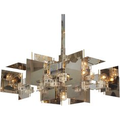 Cubist Chrome Steel, Lucite, and Brass Chandelier by Sciolari