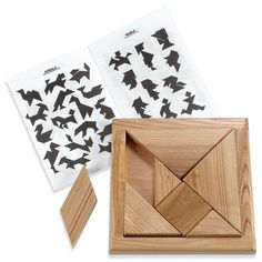 """Wooden Tangram Puzzle:Seven simple pieces. An unlimited number of designs. It's no wonder the ancient Chinese tangram has captured the imagination of children (and adults!) for centuries! Shape and pattern recognition skills are developed and creativity inspired by this exceptionally well-made version.   Thick wooden pieces are easy for small fingers to remove from the tray and manipulate. Includes 16-page booklet with 90 puzzles and solutions. 7½"""" square. Ages 4 and up."""
