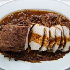 A five-spice rub, as well as oranges and dried plums, make for a mean, lean braised pork loin.