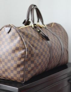 I guess the Louis Vuitton Keepall just has to be on the collection.