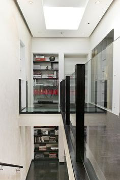 Stairway with Glass Bridge in Los Angeles home by Anne Hauck