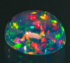 Stunning Crystal Opal with Neon Rainbow Fire #Gemstones #Opals #CrystalOpal