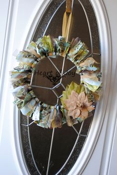 $30.00 Shades of blue, brown and green tulle and fabric wreath with a burlap flower adornment www.facebook.com/myheartofjoy heartofjoycreations@gmail.com