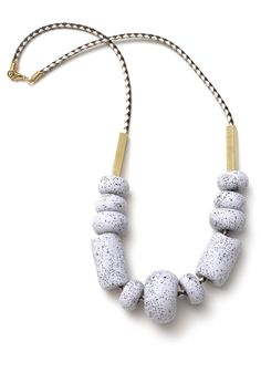 This delicious dragon fruit grey gelato toned necklace features 11 hand-formed beads with vanilla bean black speckles paired with rectangular brass...