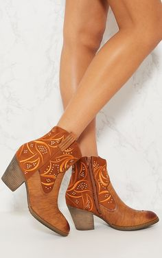 Tan Embroidered Western Ankle BootsGive your look some western feels with these ankle boots girl....