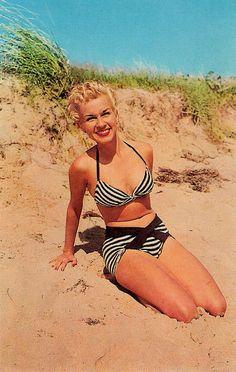 Stripes, smiles, and cute curls at the beach during the 1950s. #vintage #beach #summer #1950s #bikini #hair