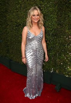 SEE ALL OF THE RED-CARPET LOOKS FROM THE 2014 EMMY AWARDS Amy Poehler Dress by Theia.