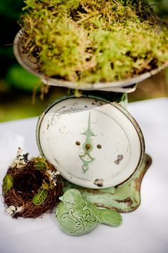 I just LOVE how they used this vintage kitchen scale - nice touch of green with the moss!
