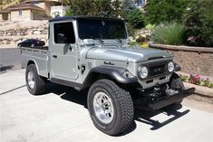 This is a rare, custom 1965 Toyota Land Cruiser FJ-45 3/4 ton pickup. This frame-off restoration includes detailed sand blasting and Rhino lining rust inhibi...